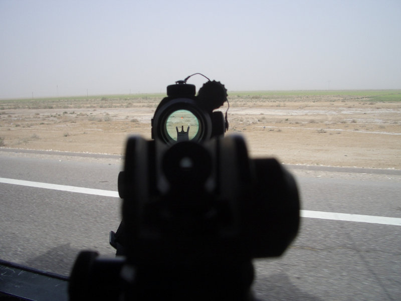 view through the Aimpoint of an M4